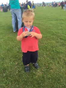 will-checking-out-his-dads-medal