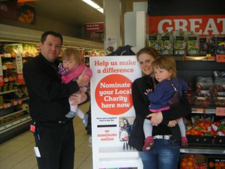 The Welters twins, Mum Tiz, and Andy Sainsbury's store manager Stanwix branch, Cumbria