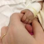 Livia holding mums hands