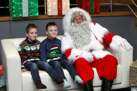 The 'Tiny Lives' Christmas reunion at St. James' Park...Twins Joshua Sharples 7 (left) and his brother Jack with Santa.......(pic Dave Charlton)