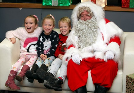 The 'Tiny Lives' Christmas reunion at St. James' Park..(L to R) Triplets Grace, Hannah and William Oliver 7 with Santa........(pic Dave Charlton)