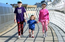 The Tiny Lives Toddle over the Millennium Bridge.(L to R) Alice McHale 10, Islay Stuart 2 and Olivia McHale 7.........(pic Dave Charlton)